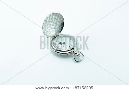 Old vintage open silver pocket watch isolated on white background.