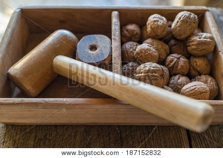 traditional appetizer walnuts with wooden hammer to crack italian breakfast Matera Italy.