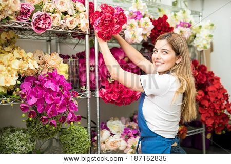 Female Worker Organizing Artificial Flowers