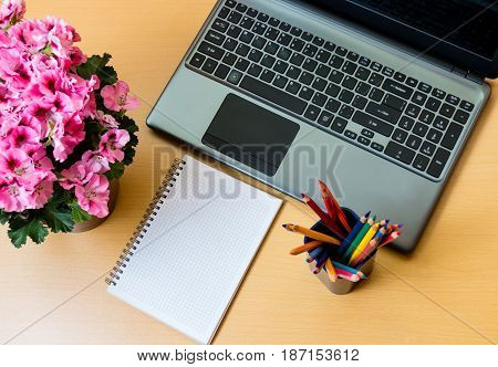 Blank notepad and laptop on office desk
