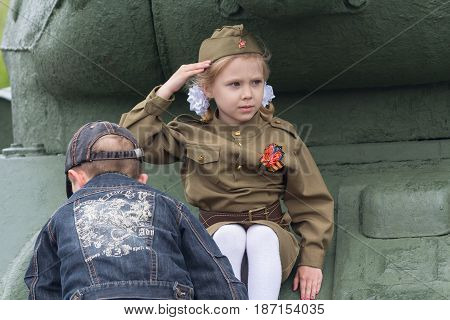 Donetsk Ukraine - May 09 2017: Girl in a military uniform of the times of the Second World War at the celebration of the anniversary of victory