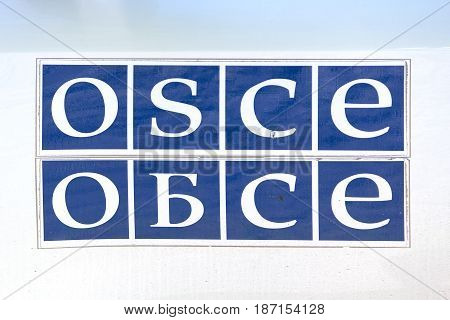 Donetsk Ukraine - May 17 2017: OSCE logo on the mission car in English and Russian