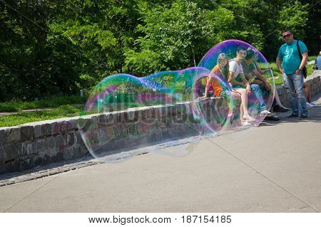 Kiev Ukraine - June 04 2016: Big bubble and vacationing citizens on the Landscape alley