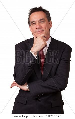 Attractive Smiling Business Man in Suit with Hand to Face