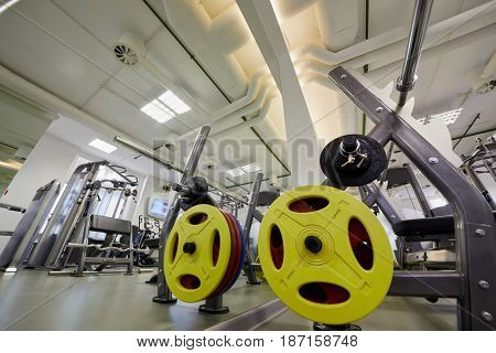 Interior of gym room with training machines.