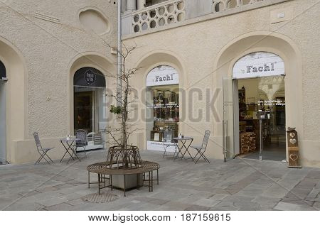 GRAZ, AUSTRIA - MARCH 20, 2017: Charming place with iron tables in patio in the old town of Graz the capital of federal state of Styria Austria.