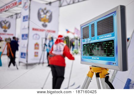 MOSCOW REGION, YAKHROMA, RUSSIA - FEB 11, 2017: Time electronic panel at Russian Ski Run 2017 competition. Russian Ski Run is held annually since 1982 and is most mass in the world.