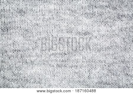 close-up of gray and white knitted fuzzy wool sweater texture