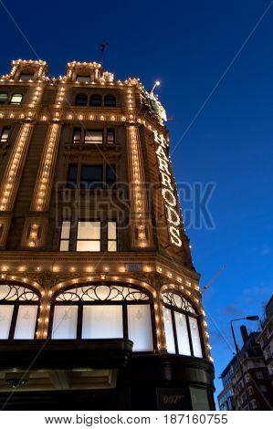 harrod's facade at dusk in london in england