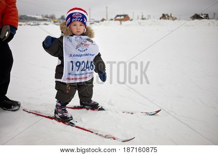 MOSCOW REGION, YAKHROMA, RUSSIA - FEB 11, 2017: Little participant of Russian Ski Run 2017 competition. Russian Ski Run is held annually since 1982 and is most mass in the world.