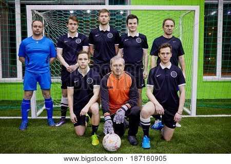 MOSCOW, RUSSIA - JAN 23, 2017: Team of futsal players poses at goalpost.