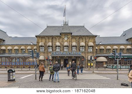 GOTHENBURG SWEDEN - MAY 13 2017: Commuters crossing the road on their way to or from the central train station in the Swedish city of Gothenburg.