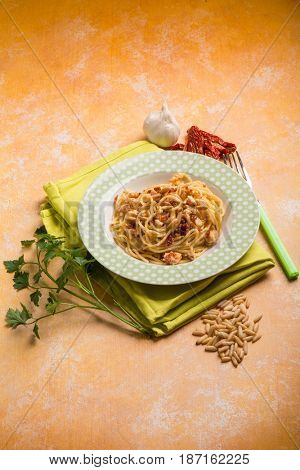 spaghetti with swordfish ragout pine nut and dried tomatoes