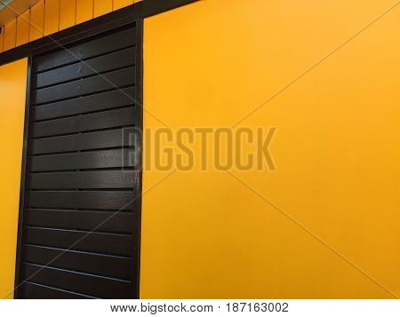 Dark Brown Wooden Door with Yellow Wall