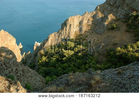 Panoramic Crimean landscape - Karadag volcanic mountain range - Ukrainian natural reserve on a Black Sea shore.