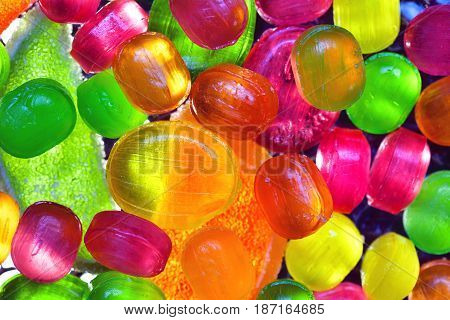 colorful background of bright candy. Sweets - lollipops