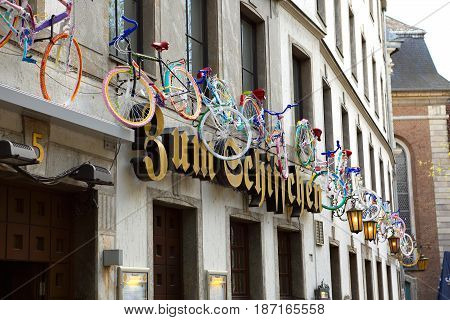 Dusseldorf Germany - May 11 2017: One of the main street in the Old city center of Dusseldorf in Germany with many colorful hanging bicycle on the old house.
