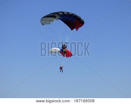 TYUMEN, RUSSIA - 13 AUGUST 2016: Airshow in Plekhanovo airport. Two parachutist in the air.
