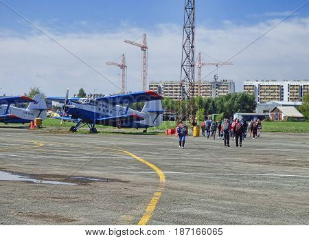 TYUMEN, RUSSIA - 13 AUGUST 2016: Airshow in Plekhanovo airport. Parachutists going to the airplain.