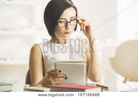 Thoughtful Girl With Notepad