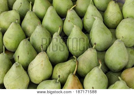 Pears on the counter for sale in a vegetable shop. Pears background. Horizontal.