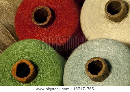 the colorful tailor thread bobbin macro shot