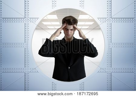 Abstract image of stressed young businessman standing in bank vault. 3D Rendering