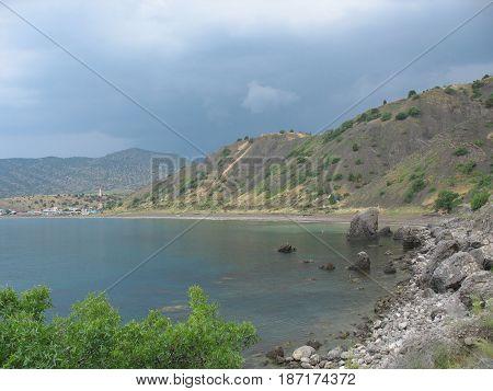 Coastal cliffs coastline rocky shore the view from the sea side Crimea peninsula Ukraine Black Sea Coast