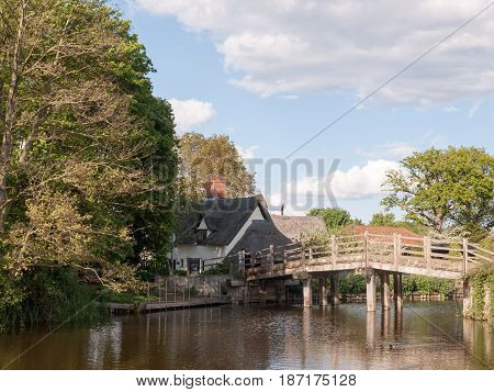 The Bridge At Flatford Mill Leading To A Cottage In The Heartland Of Constable Country Essex And Suf