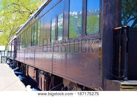 Vintage passenger railroad car taken in an industrial rail yard