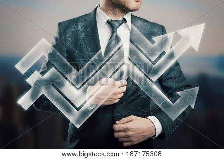 Young businessperson with abstract upward business chart arrows. Career development concept
