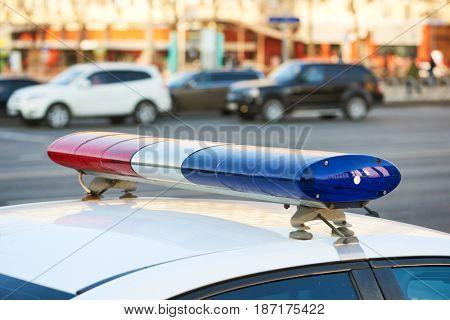 City safety. Police car on duty in urban street