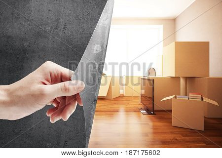 Girl's hand flipping abstract concrete page revealing new room with moving boxes. Repairs concept. 3D Rendering