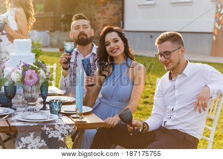 The newmarried couple and guests enjoy themselves at the Banquet table