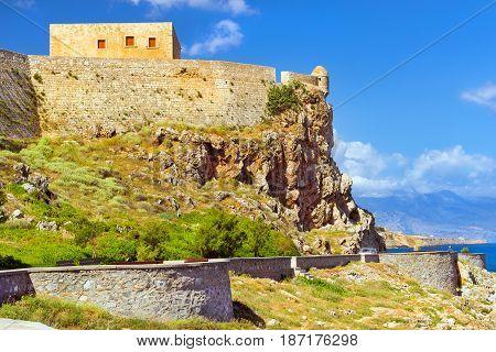 Fortezza Castle - Venetian fortress on hill Paleokastro in resort Rethymno. Greek architecture on coast of Kolpos Almirou. Highway along promenade Emmanouil Kefalogianni. Crete Greece
