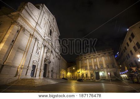 The Church of the Gesù and historic buildings in Rome, Italy. Night. The Church of the Gesù is the mother church of the Society of Jesus, a Roman Catholic religious order also known as the Jesuits.