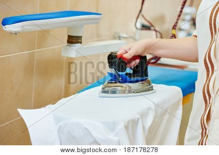 ironing service. Hand with iron