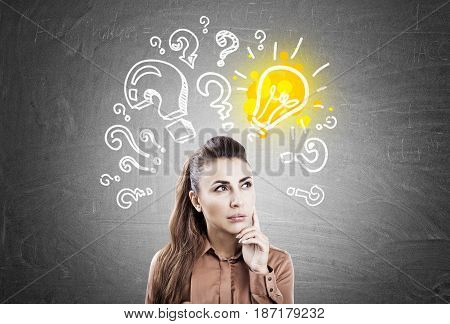 Pensive Woman, Light Bulb And Questions