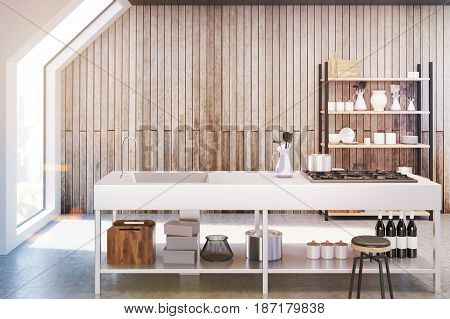 Front view of an interior of an attic kitchen with wooden walls a cooker a sink and a cupboard with dishes and cutting boards. 3d rendering mock up toned image
