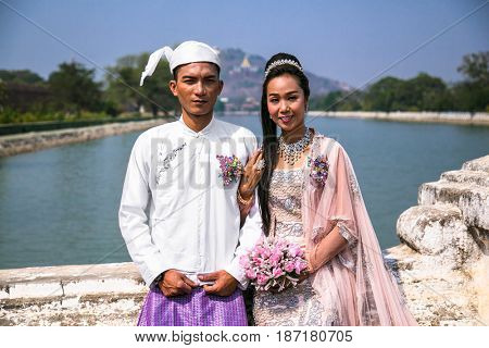 MANDALAY, MYANMAR - MARCH 7, 2017 : Burmese couple wear traditional clothes in a traditional wedding event in Mandalay on March 7, 2017, Myanmar.