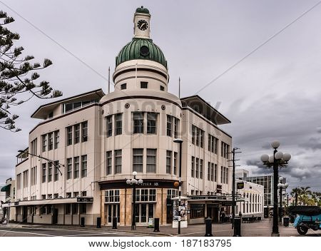 Napier New Zealand - March 9 2017: Lone Star office building with clock tower at Emerson and boardwalk intersection. Street scene with heave clouds.