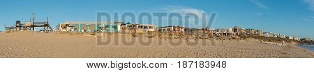 LANGEBAAN SOUTH AFRICA - APRIL 1 2017: Panorama of a beach at sunset in Mykonos in Langebaan a town on the Atlantic Coast of the Western Cape Province