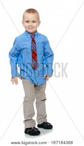Cute little blonde boy in a Blue shirt and tie.Isolated on white background.