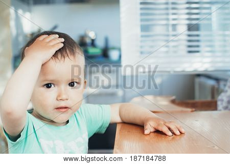 The Child Holding His Head