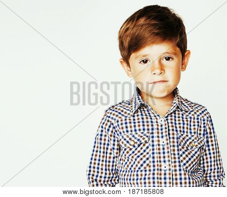 young pretty little cute boy kid wondering, posing emotional face isolated on white background, gesture happy smiling closeup, lifestyle real people concept