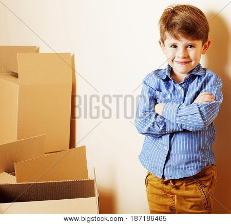 little cute boy in empty room, remoove to new house. home alone, lifestyle people concept close up