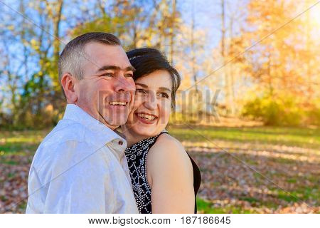 Beautiful couple girl and man walking in the park on a fall day