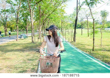 Young Asian Beautiful Woman On Bike In Green Road