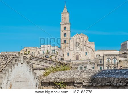 Panoramic View Of Typical Stones (sassi Di Matera) With Church In Matera Unesco European Capital Of