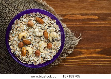 Oatmeal With Nuts (hazelnuts, Cashews, Almonds). Oatmeal On A Wooden Table. Oatmeal Top View. Health